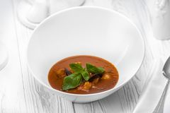 Tomato dipping sauce with vegetables in a bowl royalty free stock photo