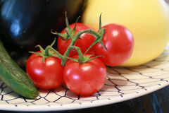 Tomato on dish on the table Stock Image
