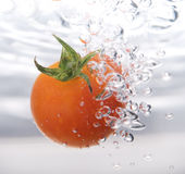 Tomato drop in water Royalty Free Stock Image