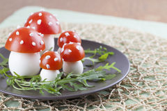 Tomato and egg fly agaric mushrooms Royalty Free Stock Photos