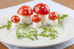Tomato and egg fly agaric mushrooms Royalty Free Stock Photo