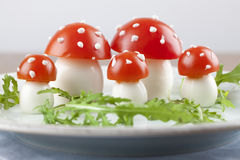 Tomato and egg fly agaric mushrooms Stock Photo