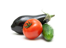 Tomato, eggplant and cucumber closeup on a white background Stock Image