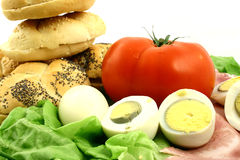 Tomato, eggs, rolls Royalty Free Stock Images