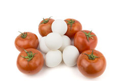 Tomato with eggs Stock Photos