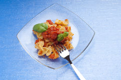 Tomato farfalle and fork Royalty Free Stock Images