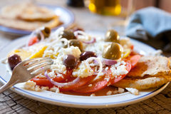 Tomato, feta & olive salad. Red and yellow tomato, crumbled feta & olive salad Stock Photography