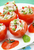 Tomato filled with tuna stock images