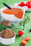 Tomato fondue. Fondue with tomatoes and shape heart bread, selective focus Stock Photography