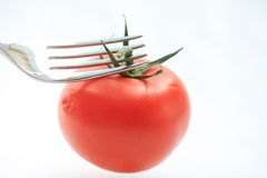 Tomato on a fork Royalty Free Stock Images