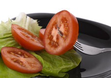 Tomato on fork Royalty Free Stock Image