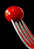 Tomato on Fork. Tomato speared by fork on black background Stock Photography