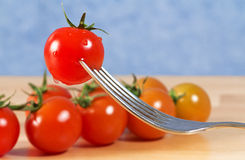 Tomato on a fork Royalty Free Stock Photography
