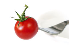 Tomato and Fork on Bowl Royalty Free Stock Image