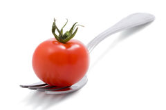 Tomato on fork isolated. Over white Royalty Free Stock Photo