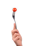 Tomato on the fork. Isolated over white background Royalty Free Stock Images