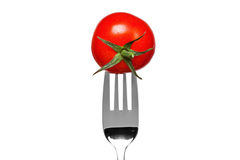 Tomato on a fork isolated on white Royalty Free Stock Photography