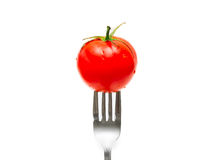 Tomato and fork Royalty Free Stock Images