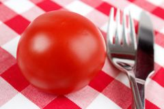 Tomato, fork and knife Royalty Free Stock Photo