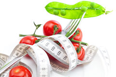 Tomato,fork and measure tape Royalty Free Stock Photos