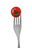 Tomato on a fork on white Royalty Free Stock Photography