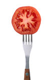 Tomato on a fork Stock Image