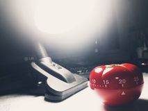 Pomodoro timer - mechanical tomato shaped kitchen timer for cooking or studying stock photos