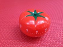 Pomodoro timer - mechanical tomato shaped kitchen timer for cooking or studying royalty free stock image