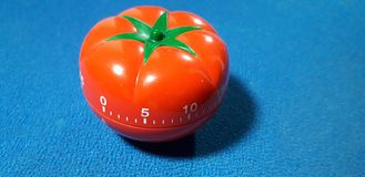 Pomodoro timer - mechanical tomato shaped kitchen timer for cooking or studying royalty free stock photo