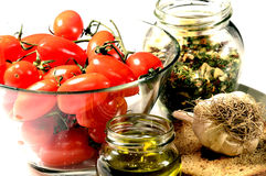 Tomato , fresella , oil, garlic , oregano. Ingredients of a dish of traditional food of southern Italy called  Fresella Royalty Free Stock Images