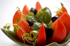 Tomato with fresh herbs Stock Images