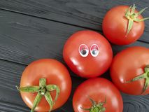 Tomato funny cartoon on black wooden. 