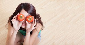Tomato. funny girl showing tomatos Stock Photos