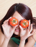 Tomato. funny girl showing tomatos Stock Photo