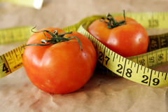 Tomato fwith measuring tape royalty free stock photos