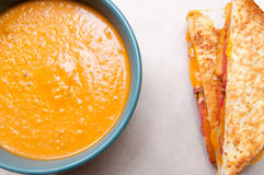 Tomato garbanzo soup made with coconut milk with grilled cheese a. Tomato garbanzo soup with coconut milk with grilled cheese and tomato sandwich. A healthy meal Stock Photography