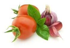 Tomato with garlic and basil royalty free stock photos