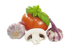 Tomato garlic basil and champignon Stock Photography