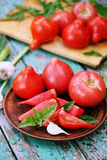 Tomato, garlic and basil Stock Photos