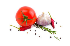 Tomato, garlic, chili peppers and rosemary. Vegetables tomato garlic chili peppers and rosemary isolated on white background Stock Photos