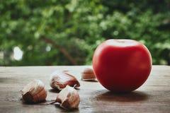 Tomato and garlic cloves Royalty Free Stock Photo