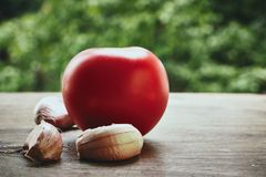 Tomato and garlic cloves Royalty Free Stock Images