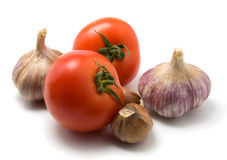Tomato and garlic isolated on white. Closeup Royalty Free Stock Image