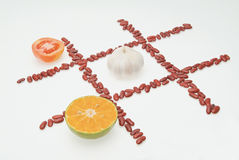 Tomato and garlic and orange Stock Photos