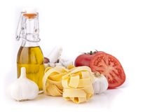 Tomato, garlic,pasta and olive oil Stock Images