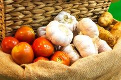 Tomato garlic and potato on a sack. Tomato, garlic and potato on a sack Stock Photos