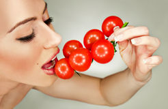 Tomato girl Stock Photo
