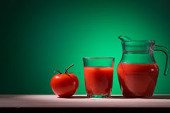Tomato glass and jug with tomato juice Stock Photography