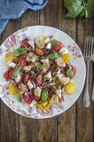 Tomato and goat's cheese salad Stock Photography
