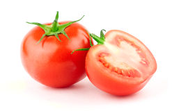 Tomato with green leaf Royalty Free Stock Photo